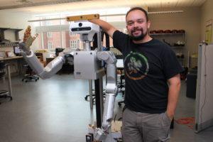 Chris Reardon and a Meka robot